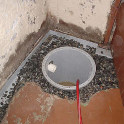 Installing a sump in a sump pump liner in a Sparta home