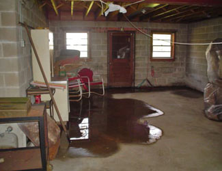 a flooded basement floor in a Mount Pocono home